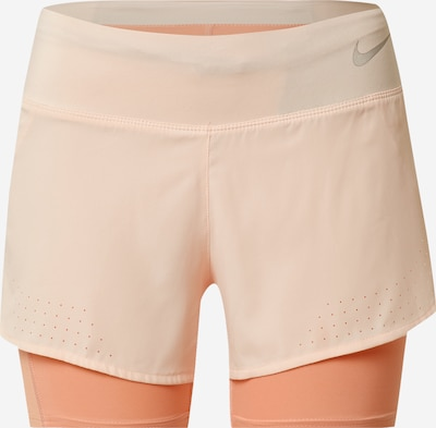 NIKE Pantalon de sport 'ECLIPSE' en corail / pêche, Vue avec produit
