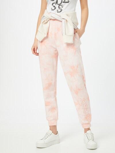 GUESS Kalhoty - broskvová / bílá, Model/ka