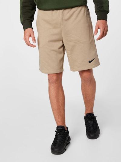NIKE Športové nohavice - púdrová / čierna, Model/-ka