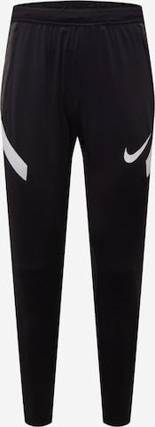 Pantalon de sport 'Strike' NIKE en noir
