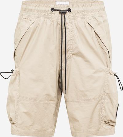 Pantaloni cu buzunare Calvin Klein Jeans pe bej deschis, Vizualizare produs
