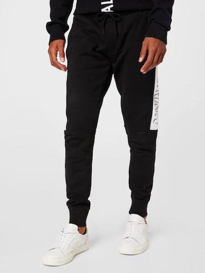 Calvin Klein Jeans Nohavice - čierna / biela, Model/-ka