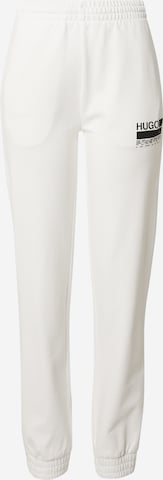 Pantaloni de la HUGO pe alb