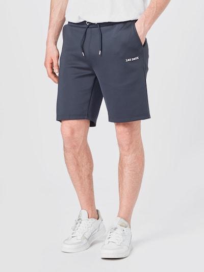 Les Deux Pantalon en bleu marine / blanc, Vue avec modèle